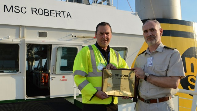 PICTURE - Graham Turner presents plaque to Pulyaevskiy Ilya