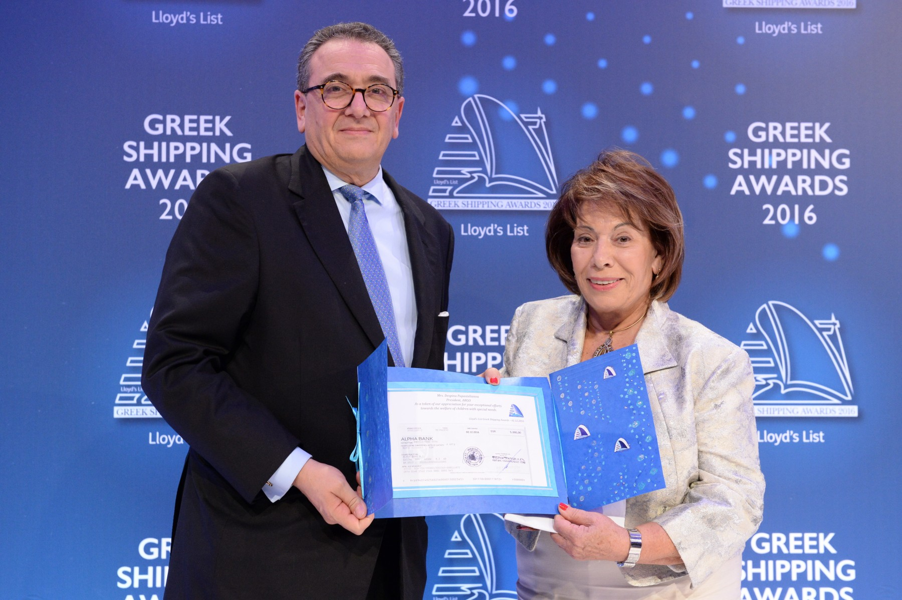 Mr. George D. Pateras of the Hellenic Chamber of Shipping presenting the Lloyd's List Greek Shipping Awards annual donation to ARGO, accepted by Mrs. Despina Papastelianou