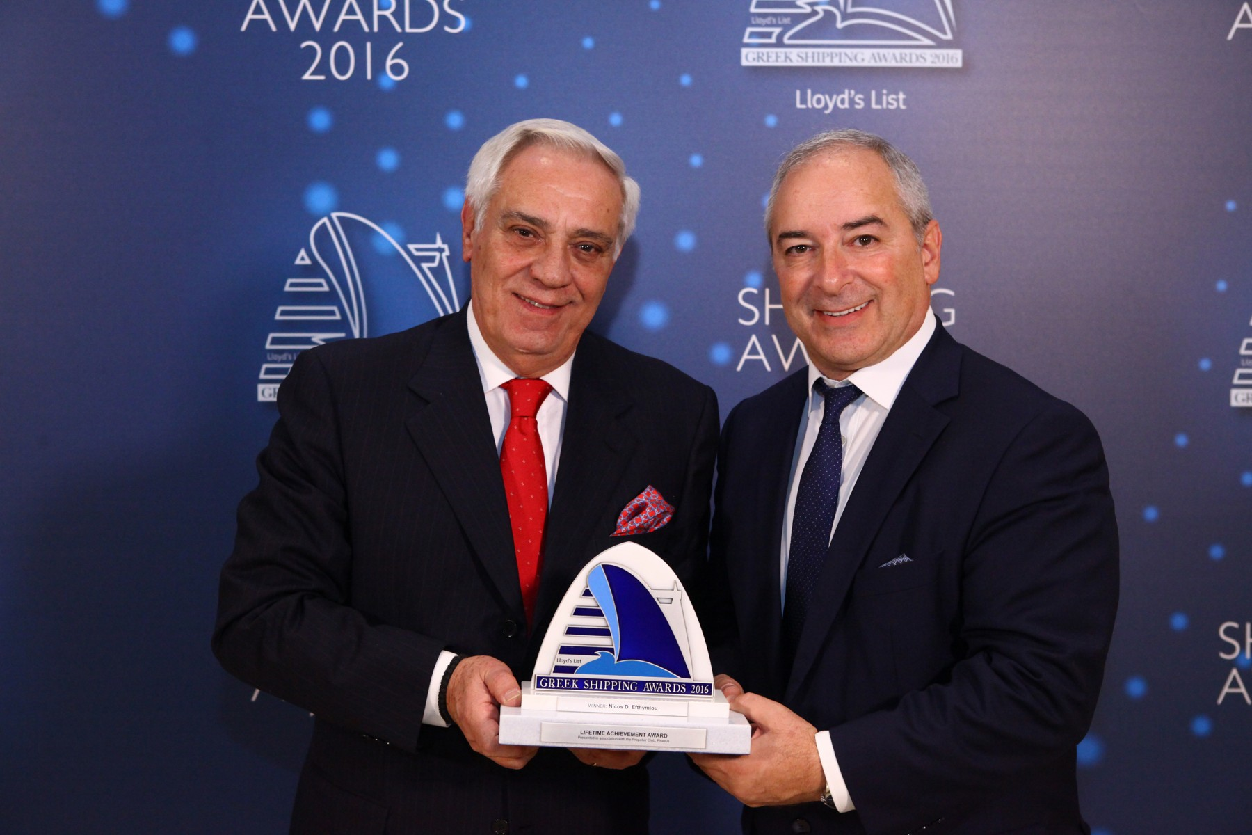 19Mr. Nicos D. Efthymiou receiving the Lloyd's List/Propeller Club Lifetime Achievement Award from Mr. Vassilis Kroustallis of sponsor ABS