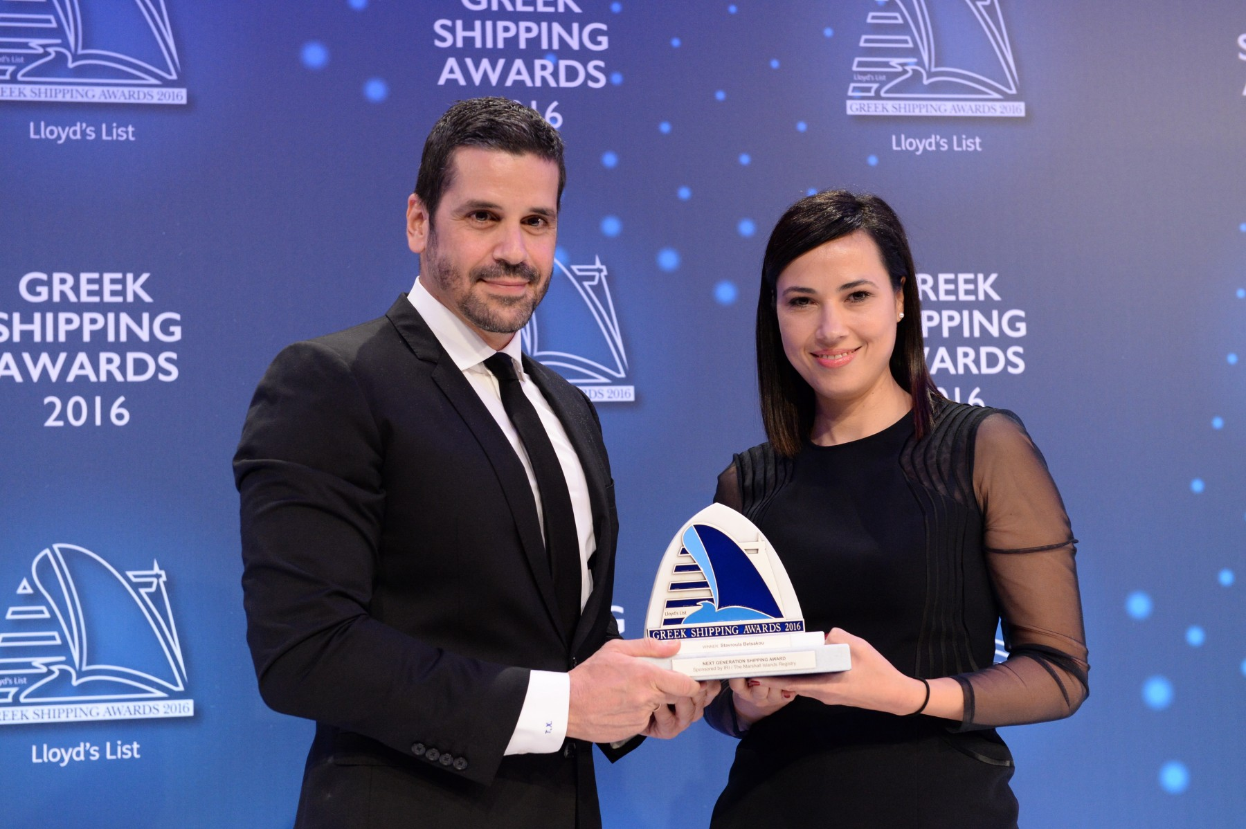 Mr. Theofilos Xenakoudis of sponsor IRI/The Marshall Islands Registry presenting the Next Generation Shipping Award to Ms. Stavroula Betsakou.