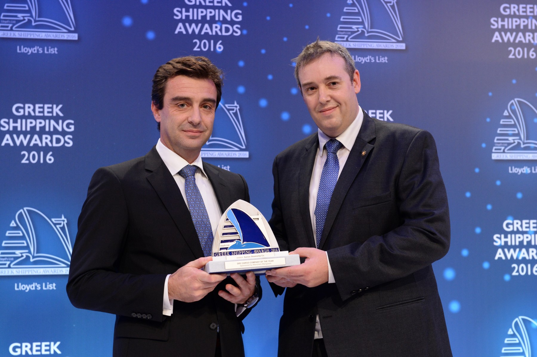 Mr. Anastasios Tzamouranis of Samos Steamship Co. accepting the Dry Cargo Company of the Year Award from Matthew More of sponsor Marichem Marigases.