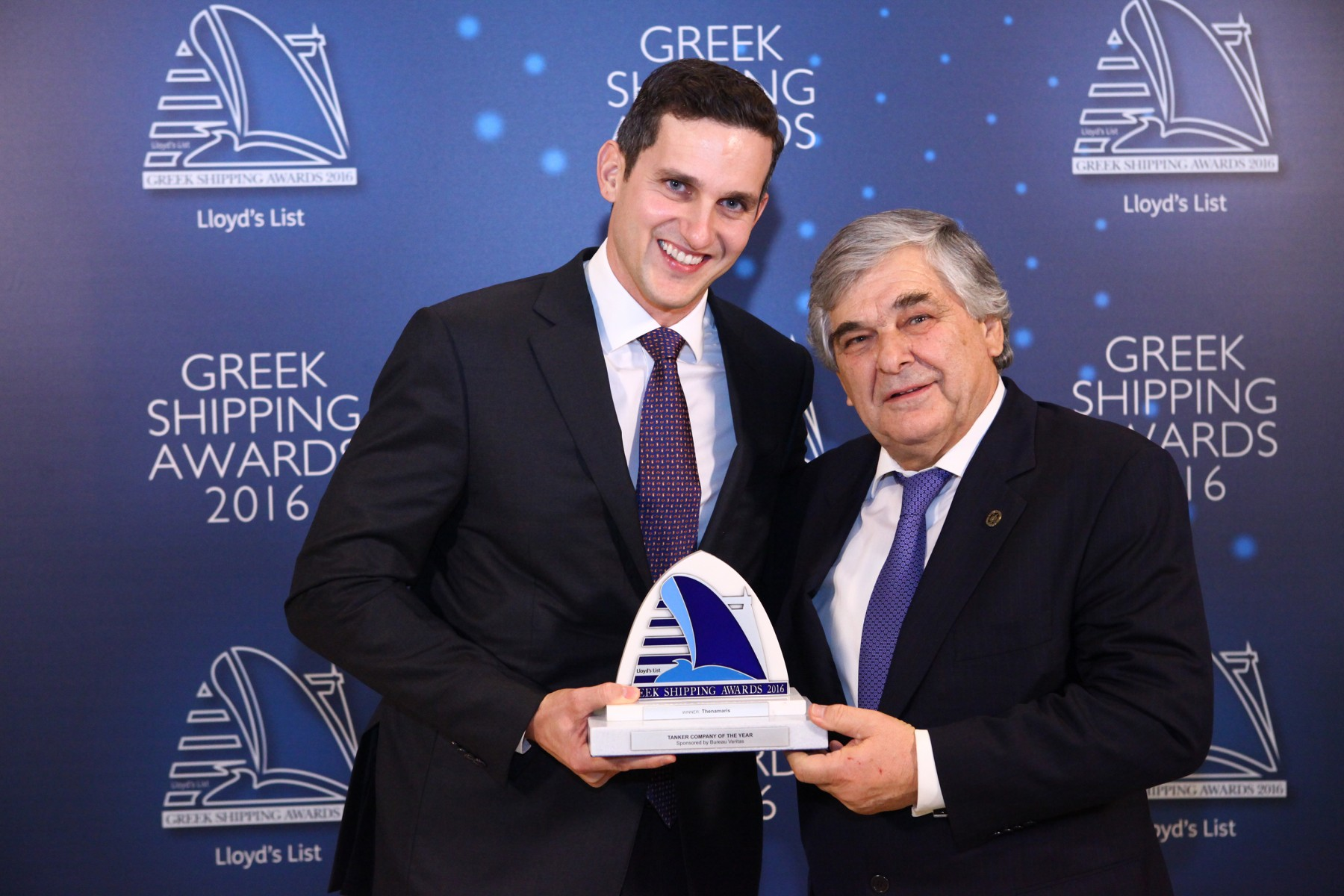 Mr. Nikolas Martinos of Thenamaris accepting the Tanker Company of the Year Award from Mr. Lambros Chahalis of sponsor Bureau Veritas.