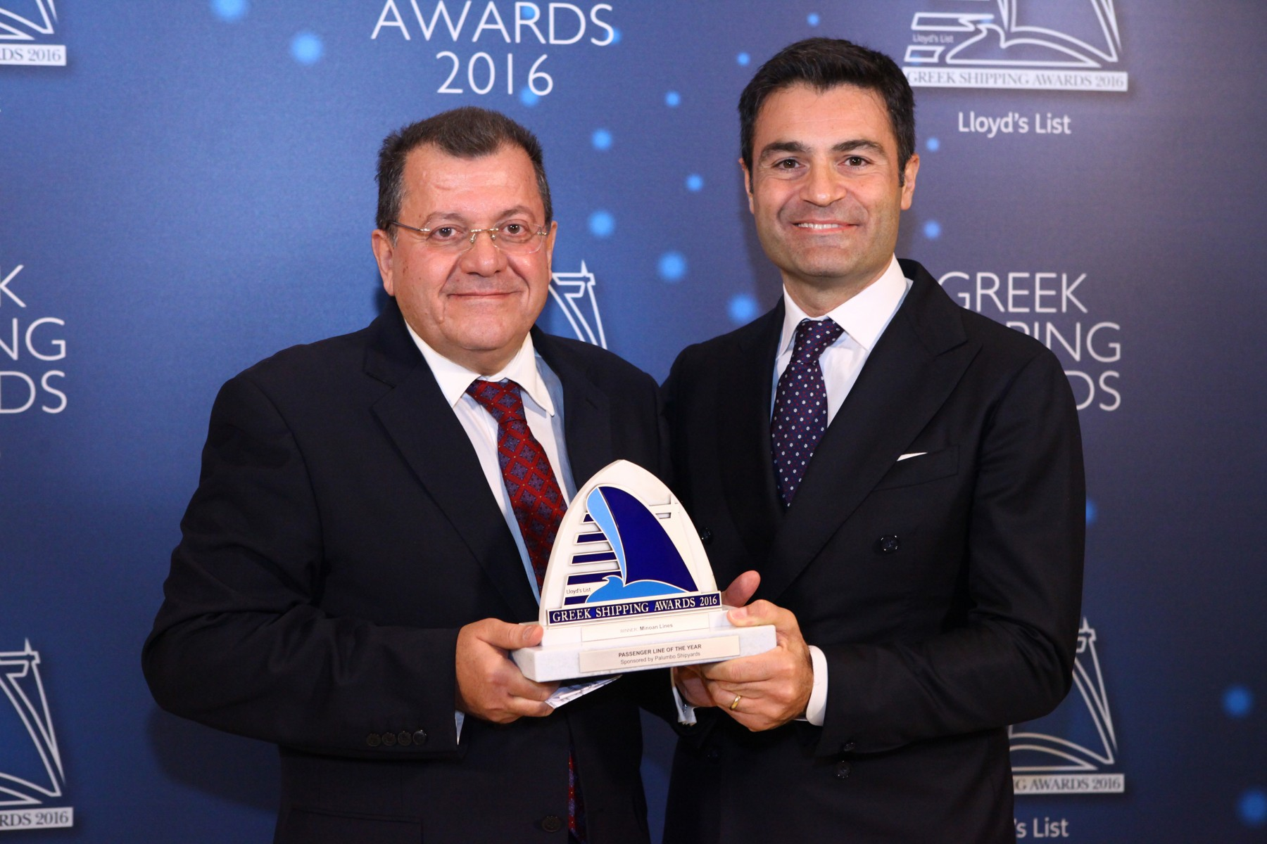 Mr. Antonis Maniadakis of Minoan Lines accepting the Passenger Line of the Year Award from Mr. Raffaele Palumbo of sponsor Palumbo Group.