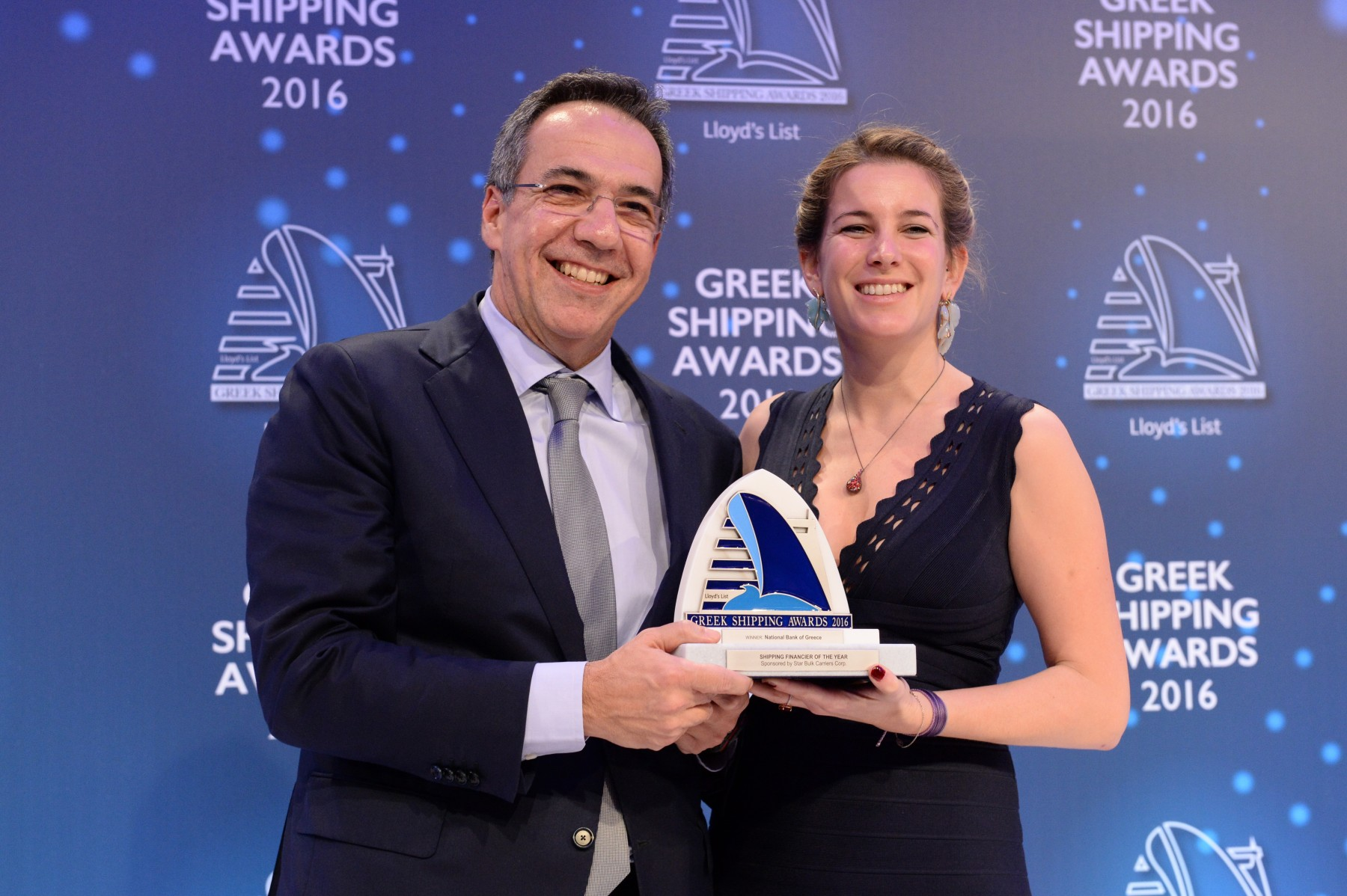 Mr. Leonidas Fragkiadakis of National Bank of Greece accepting the Shipping Financier of the Year Award from Ms. Milena Pappas of sponsor Star Bulk Carriers Corporation