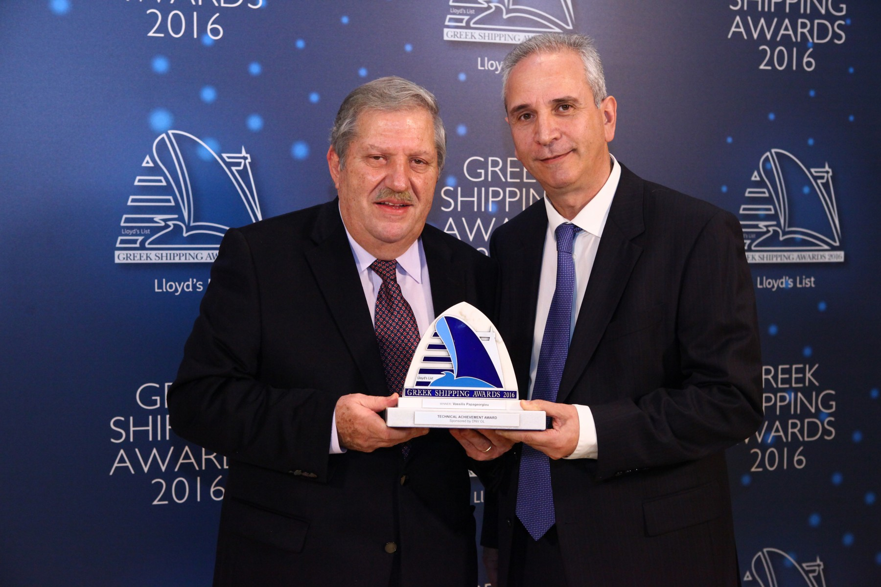 Mr. Vassilios Papageorgiou accepting the Technical Achievement Award from Mr. Loizos Isaias of sponsor DNV GL.