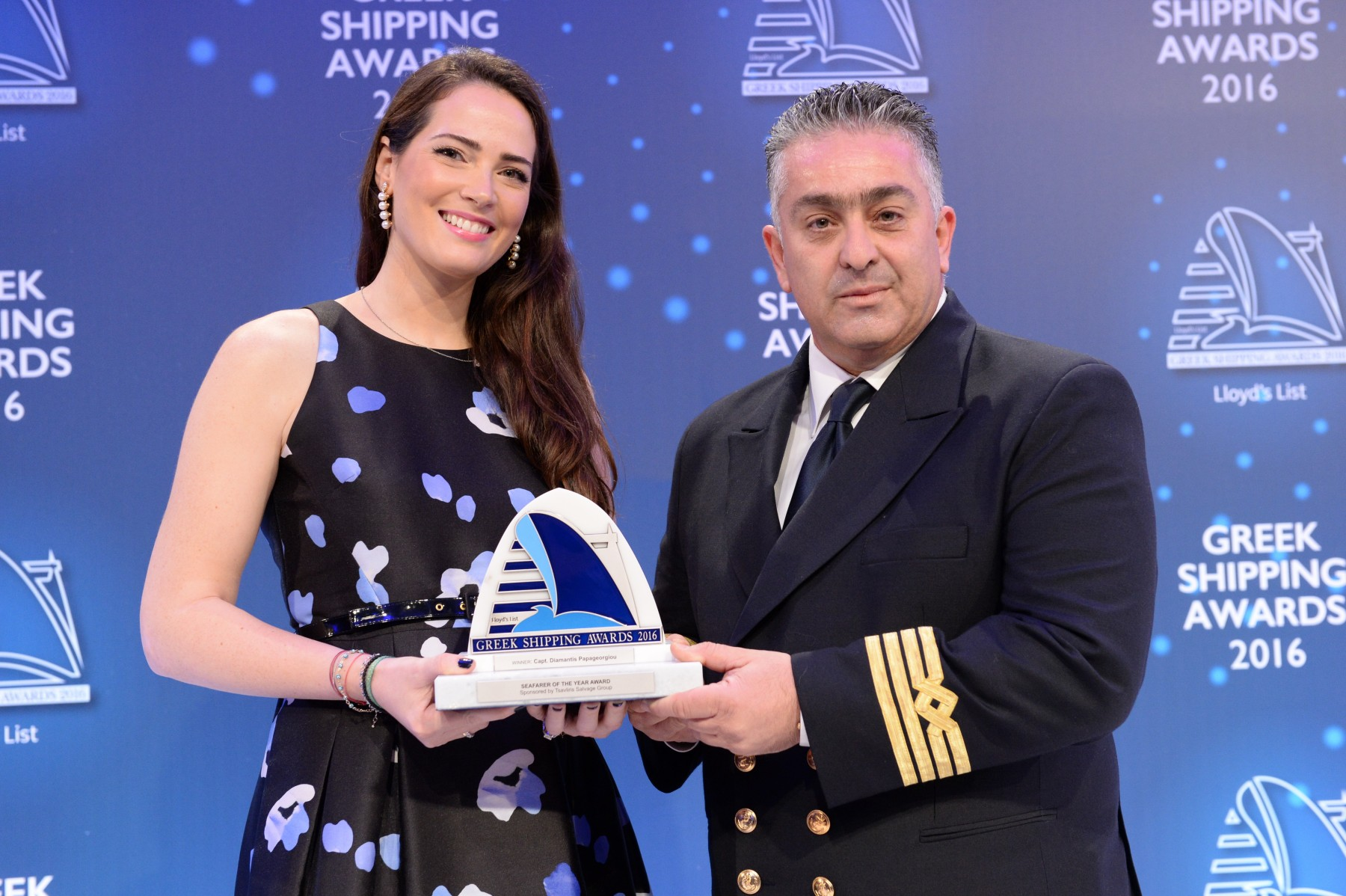 "Ms. Natalia Tsavliris-Vasilopoulos of sponsor Tsavliris Salvage Group presenting the Seafarer of the Year Award to Capt. Diamantis Papageorgiou of ""Nissos Rodos""."