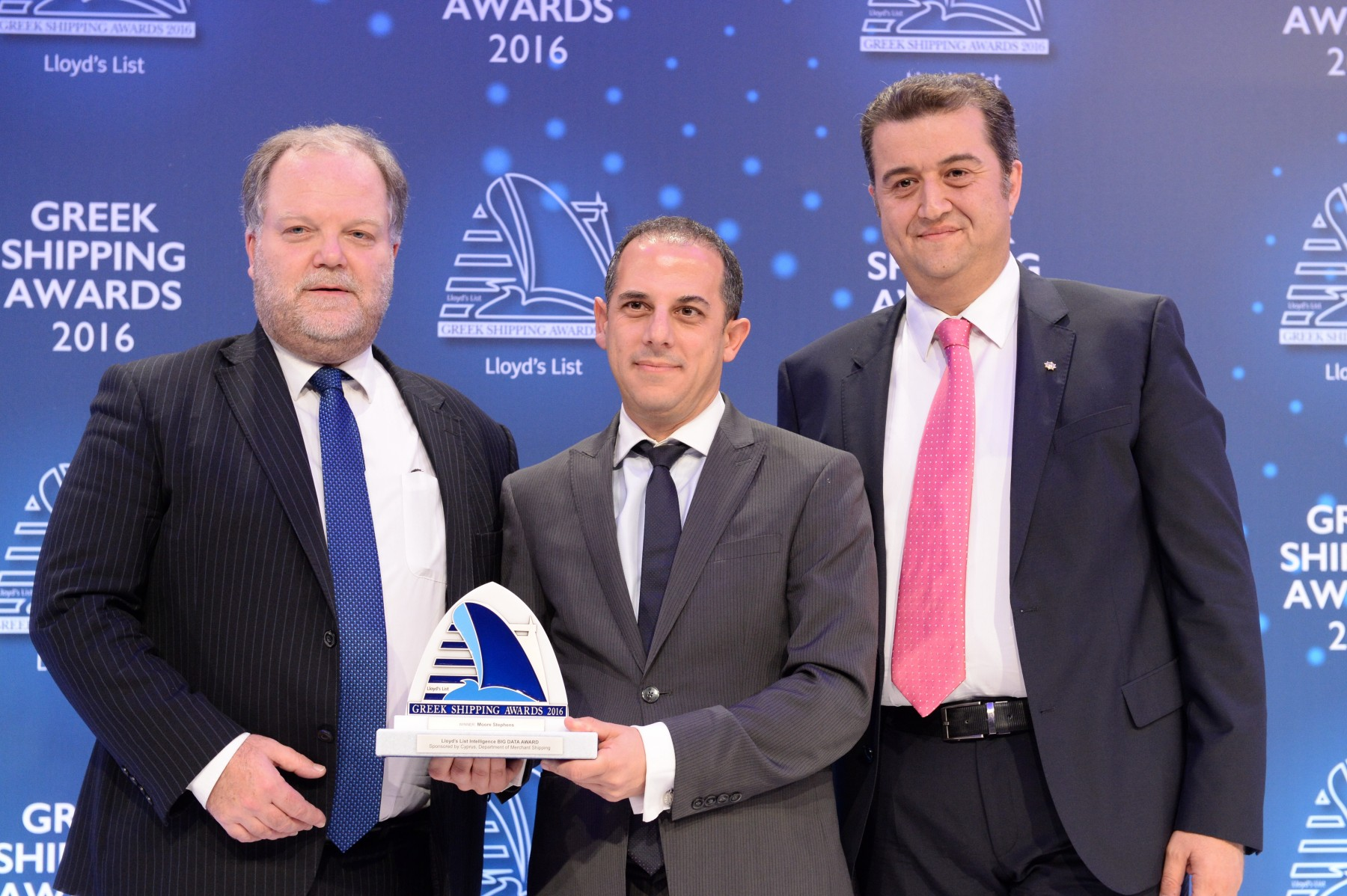 Cyprus' Transport, Communications and Works Minister Marios Demetriades (centre) presenting the Lloyd's List Intelligence Big Data Award to Mr. Richard Greiner and Costas Constantinou of Moore Stephens. The Award was sponsored by the Department of Merchant Shipping of Cyprus.